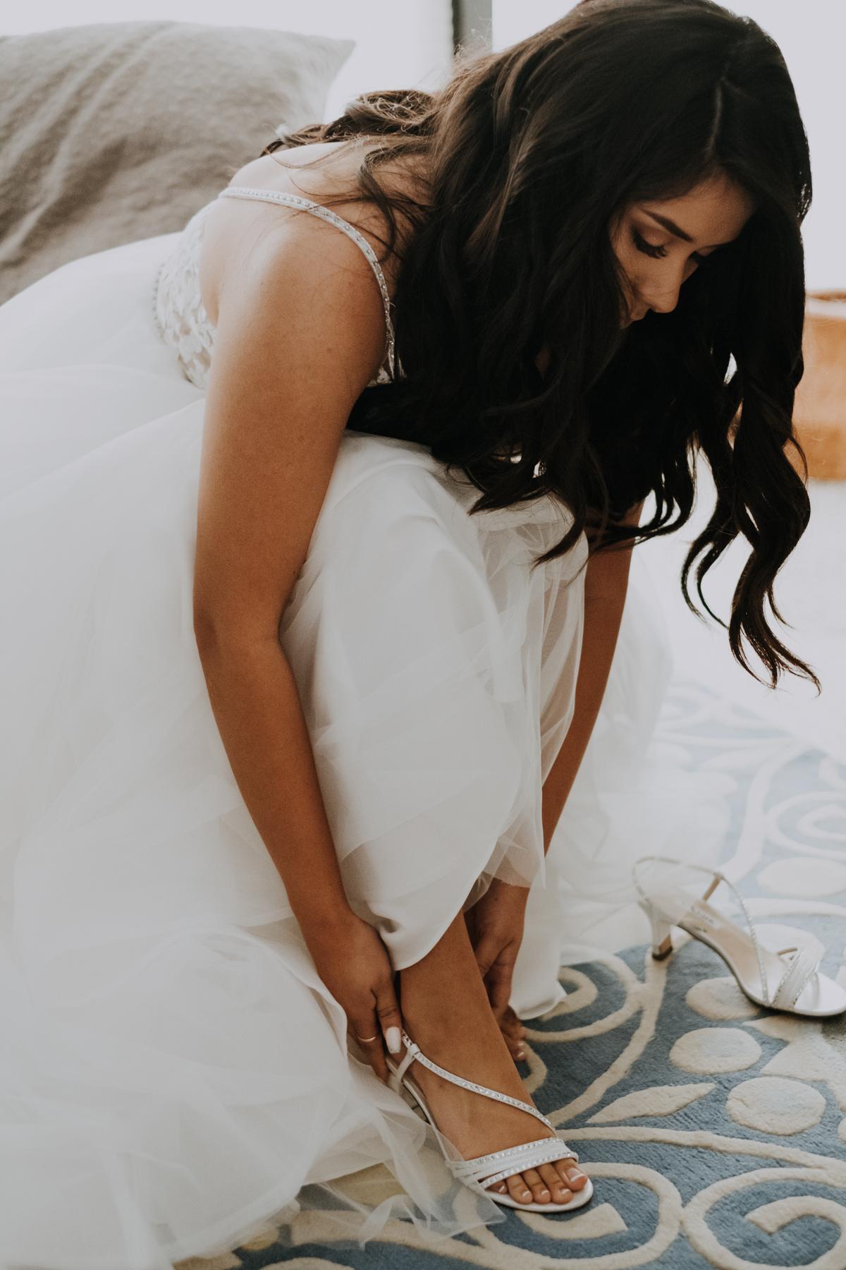 putting on the wedding heels | the perfect dress sarasota