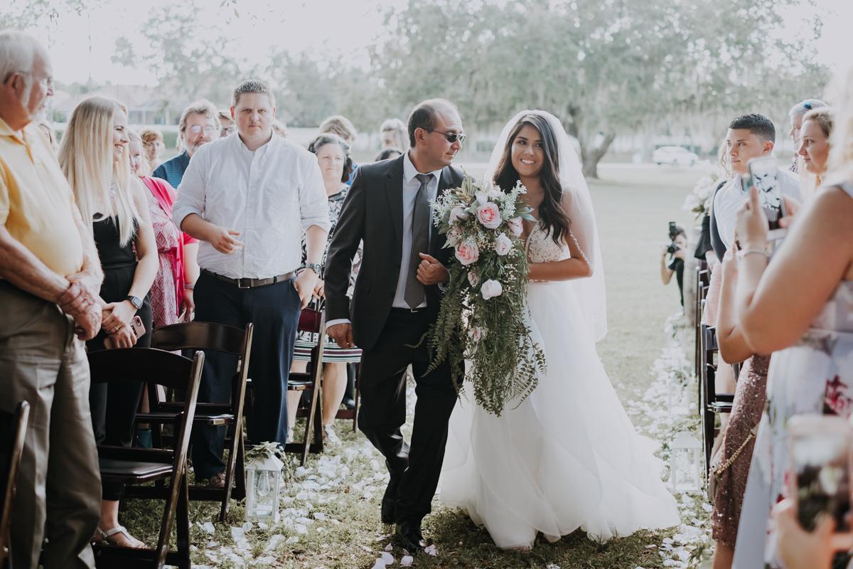 bride walking down the aisle | boho bride | romantic sarasota wedding photographer | romantic sarasota wedding | tampa wedding photographer | freehearted film co