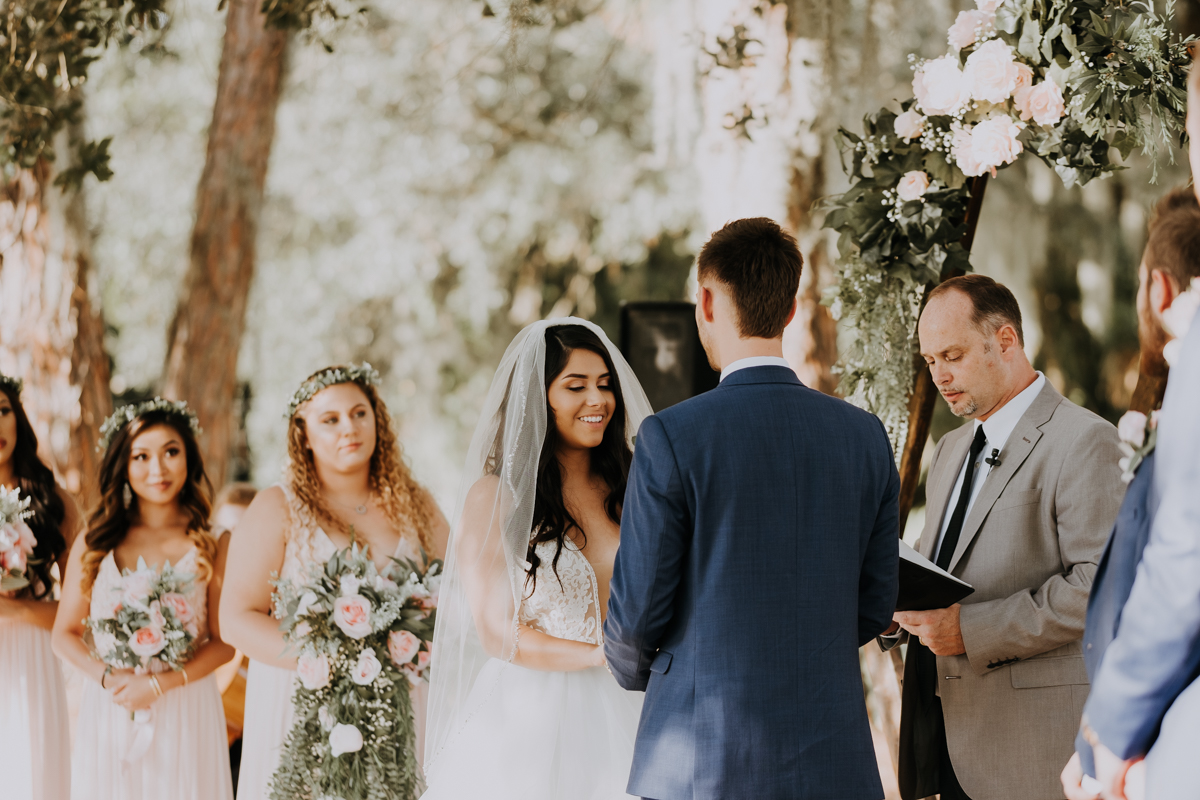 creating your wedding day timeline | bride and groom at the altar | outdoor Florida wedding | boho wedding | romantic sarasota wedding photographer | romantic sarasota wedding | tampa wedding photographer | freehearted film co